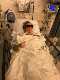 Me after my double mastectomy, wearing my sisters sunglasses because everything was so bright